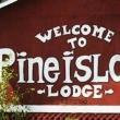 Welcome to Pine Island Lodge Sign